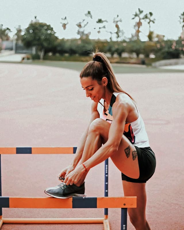 Ivet Lalova Collio tieing shoelace at track