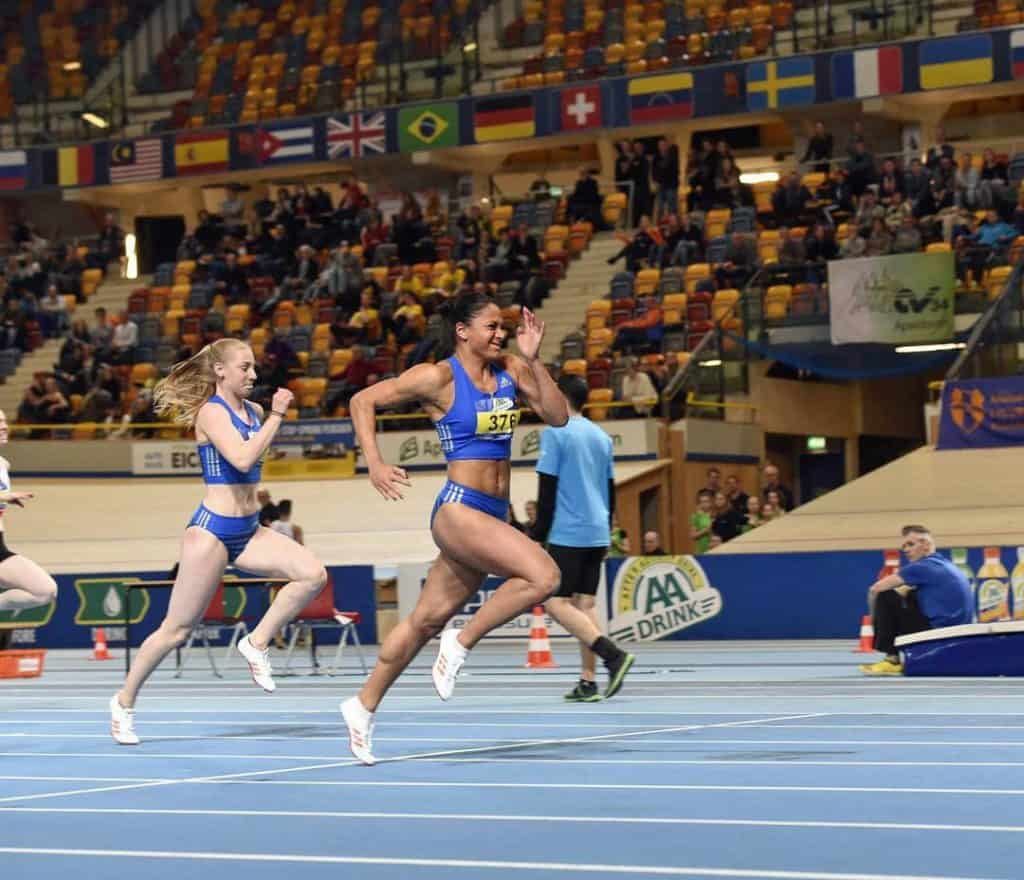 Naomi Sedney sprinting in competition