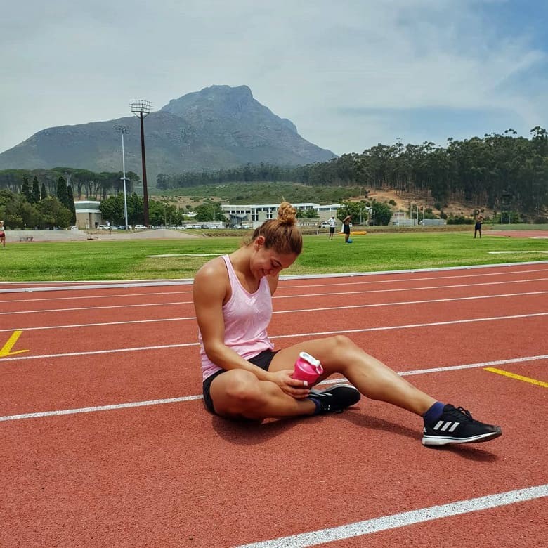 naomi sedny sitting on the track
