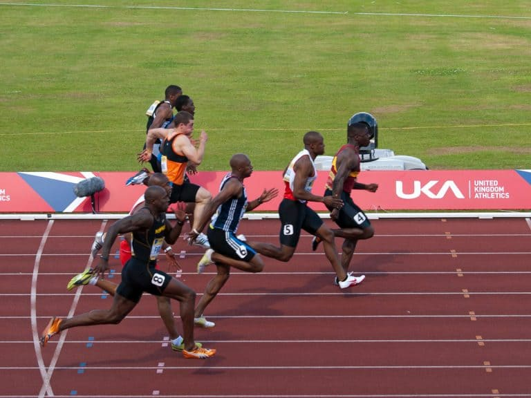 Sprinters running in the 100m final Aviva