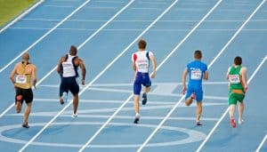 Athletes running the home straight of the 200m