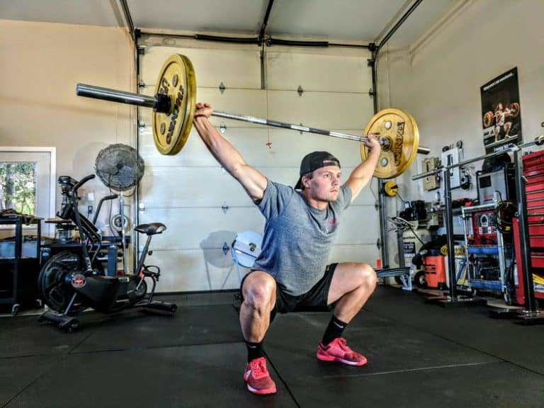 An athlete performing a squat snatch