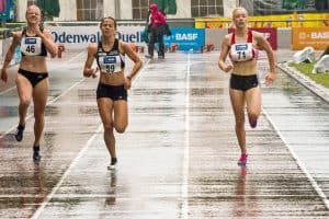 Women running 100m in the rain
